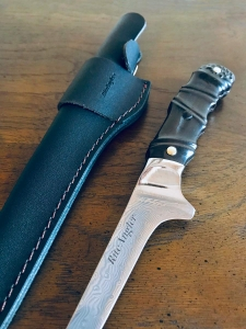 Product photography damascus steel fillet knife and sheath